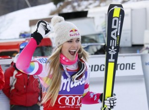 Lindsey Vonn of the U.S. celebrates after winning the women's World Cup Downhill skiing race in Val d'Isere, French Alps, December 20, 2014. REUTERS/Robert Pratta (FRANCE - Tags: SPORT SKIING)
