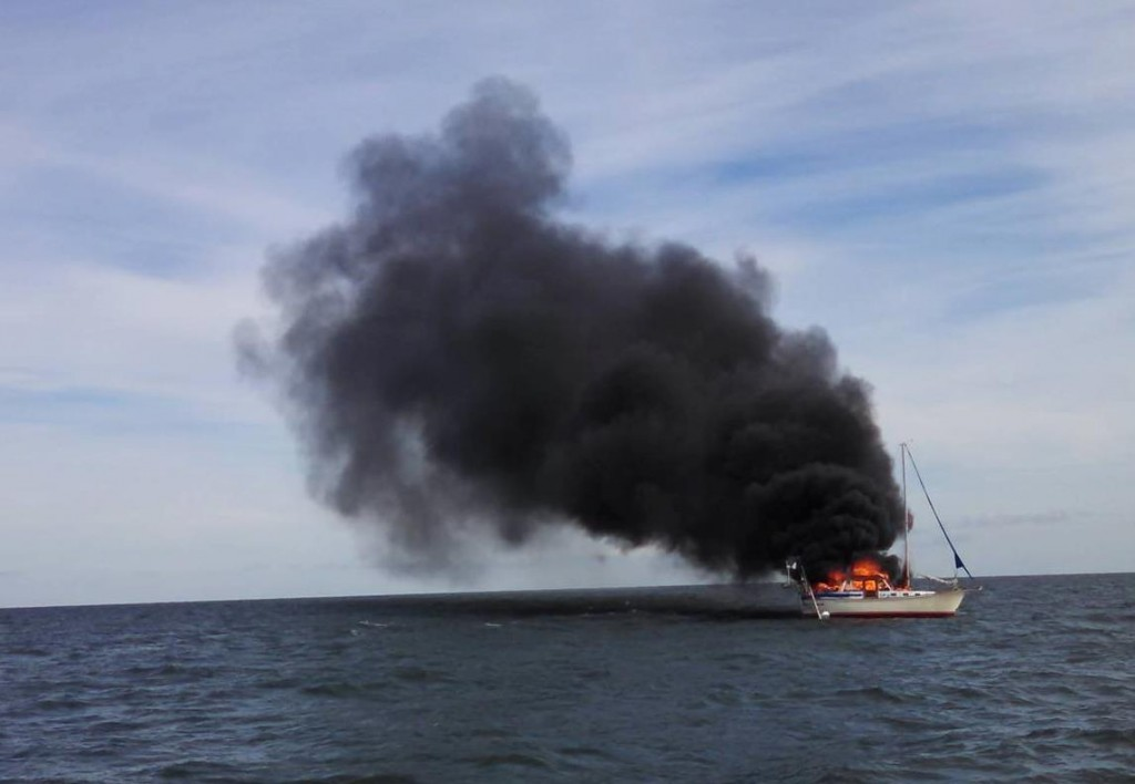 USCG-Rescues-Man-from-Burning-Sailboat