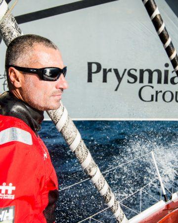 Giancarlo Pedote a prua della sua Prysmian Group. © Martina Orsini